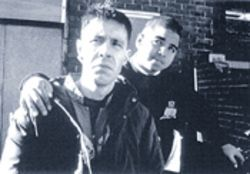 Morell (Paddy Considine, left) is a likable man-child who befriends Romeo (Andrew Shim)