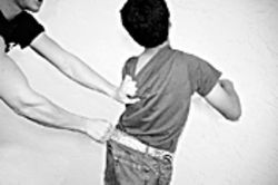 Children reported being restrained by other kids in this technique called belt looping.