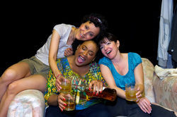 Pilar Uribe, Lela Elam, and Jacqueline Laggy kick off Sunday with a stiff one.