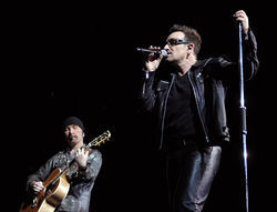 The Edge and Bono: It's  a beautiful day.