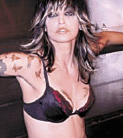 Gina Gershon, tattooed and tough as nails