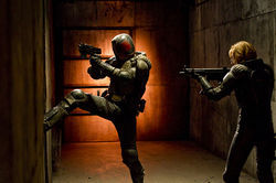 Karl Urban as Judge Dredd and Olivia Thirlby as Anderson in Dredd 3D.