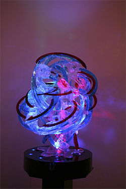 Rondo, a sculpture of blue and red translucent ribbons, was one of the Lumonics pieces at Art Basel.