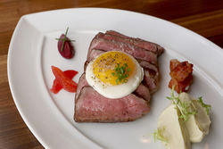 Nothing to complain about: Prime Creekstone flank steak, with crispy potato, garlic aioli, and fried egg.