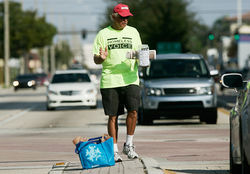 Cononie's vans drop newspaper hawkers off at intersections in Dade and Broward counties each morning. Holidays are the best for donations.