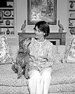 Peggy Dean, shown at home with her poodle, Ruby, organized this year&#039;s opening tea party