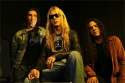 Alice in Chains' Jerry Cantrell (center) keeps the name alive.