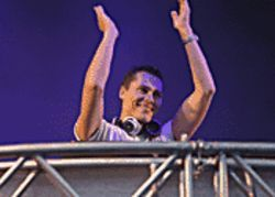 Tiësto brings the happy-happy joy-joy to the party.