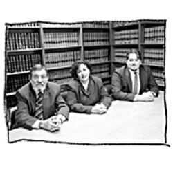 Assistant Public Defenders Bill Laswell and Dorothy Ferraro, as well as intern Jeremiah Mulligan (right), worked on Kevin Moore's defense for 17 months.