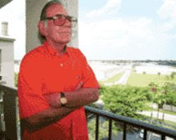 Trained to complain: John Spahlinger stands on his condo balcony, which overlooks a troublesome set of tracks