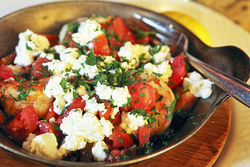 Butterflied colossus shrimp baked with tomatoes, feta cheese, fresh herbs, and olive oil.