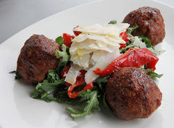 Pan-fried meatballs served over roasted red peppers and shaved pecorino Romano.