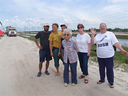 Members of the Palm Beach County Environmental Coalition (including Alex Larson, right) visit the site where a natural gas pipeline was being laid. Millions of gallons of oil will be stored nearby as backup fuel.