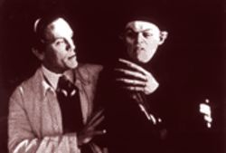 Murnau (John Malkovich) claims there&#039;s a &quot;Method&quot; to Schreck (Willem Dafoe)&#039;s madness