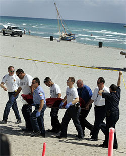Rescue workers carry the body of one Haitian ashore at Hallandale Beach, March 28, 2007.