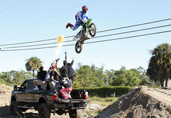 As part of a radio stunt, Rob jumped a dirt bike over a truck full of friends.