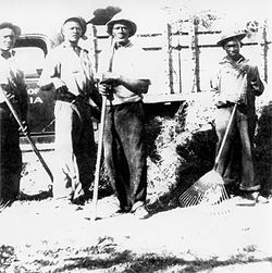 Workers from the Dania Public Works Department clean up after the 1947 hurricane.