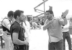 The write man for the job: Chris McQuarrie, right, directs Ryan Phillippe on the set of The Way of the Gun.